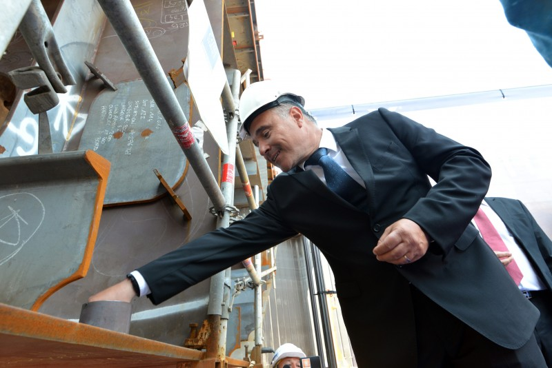 Costas Nestoroudis, Captain of Celebrity Edge sets the ceremonial coin during the keel laying for the next generation ship. Photo Courtesy of STX France – Bernard Bige
